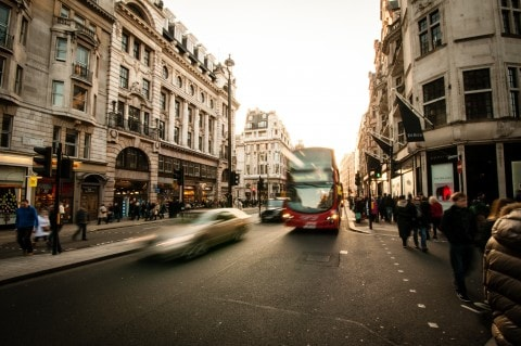 Busy London streets with cars and busses on the road