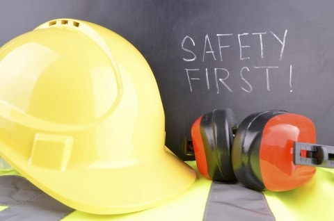 Safety helmet and ear protection with the safety first sign