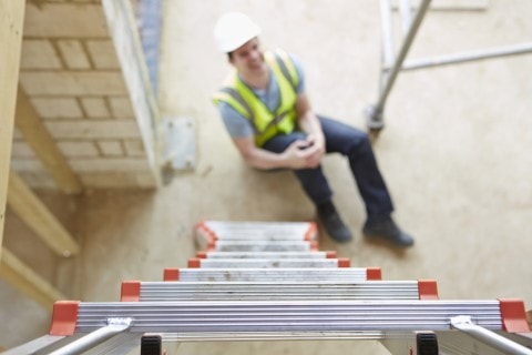 Man injuring himself after a fall from the ladder